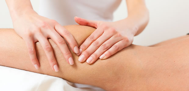 Deep tissue sports massage on woman's calf image