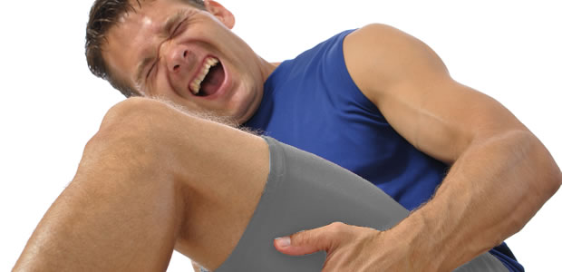 Man clasping hamstring in pain requires physiotherapy Sevenoaks for help with sports injury image